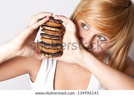 portrait of young woman with chocolate chip cookies - stock photo