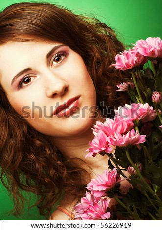 Portrait of young woman with chrysanthemums
