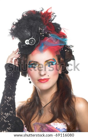 Portrait of young woman with creative visage in corset and pretty hat.