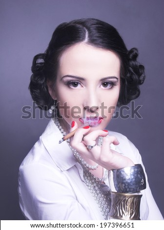Portrait of young woman with dark hair in retro style. - stock photo