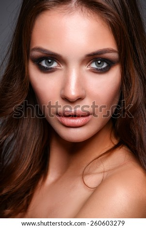 Portrait of young woman with fashion makeup - stock photo
