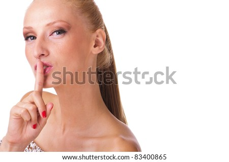 Portrait of young woman with finger on lips - stock photo