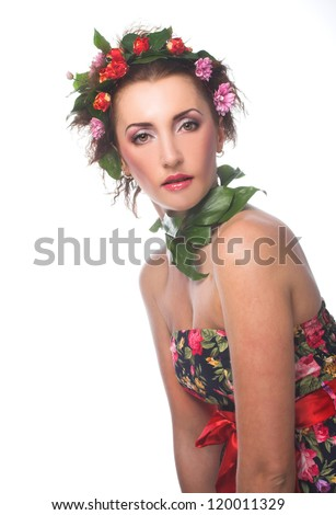 Portrait of young woman with flowers in her hair