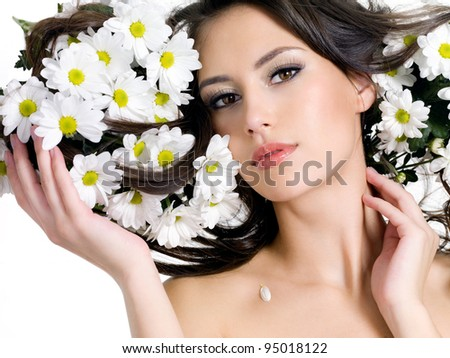 Portrait of young woman with flowers in her long hair - horizontal - stock photo