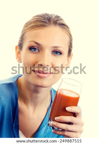 Portrait of young woman with glass of tomato juice, healthy eating and dieting concept.  - stock photo