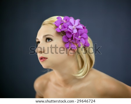 Portrait of young woman with hairstyle and flowers