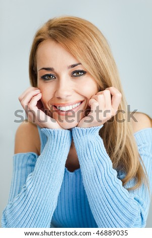 portrait of young woman with hands on chin, looking at camera. Vertical shape - stock photo