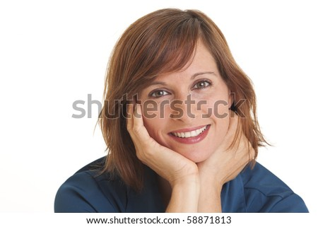 Portrait of young woman with head in hands - stock photo