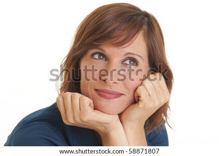Portrait of young woman with head in hands looking in contemplation - stock photo