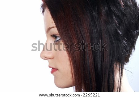 portrait of young woman with interesting haircut - stock photo