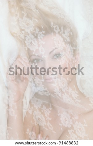 portrait of young woman with lace on her face - stock photo