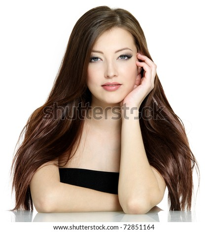 Portrait of young woman with long brown straight hair on white background - stock photo