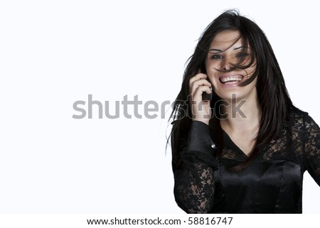 Portrait of young woman with messy hair on the phone, studio shot isolated on white background - stock photo