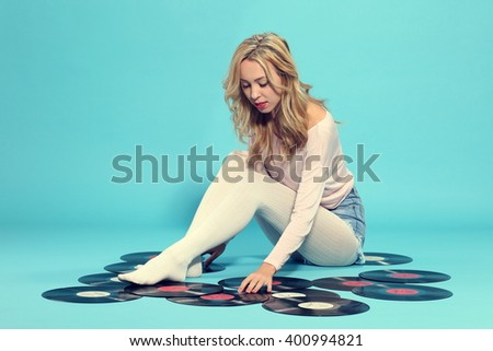Portrait of young woman with old vinyl record  - stock photo