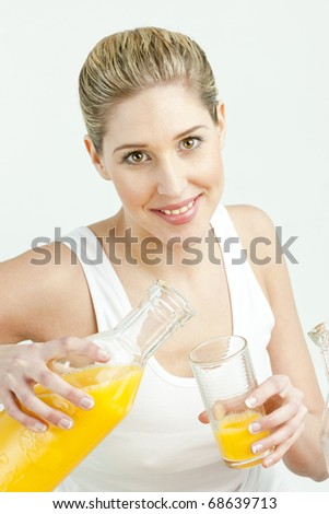 portrait of young woman with orange juice - stock photo