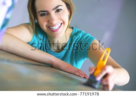 portrait of young woman with painting tools - stock photo
