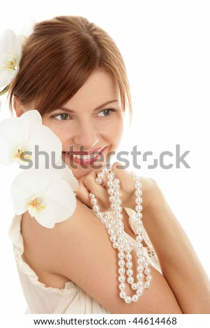 Portrait of young woman with pearls and orchid isolated on white background - stock photo
