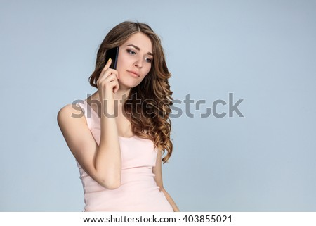 Portrait of young woman with phone - stock photo