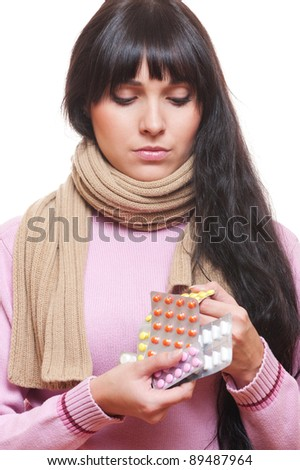 portrait of young woman with pills over white background - stock photo