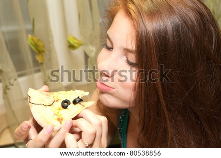 Portrait of young woman with pizza atrestaurant - stock photo