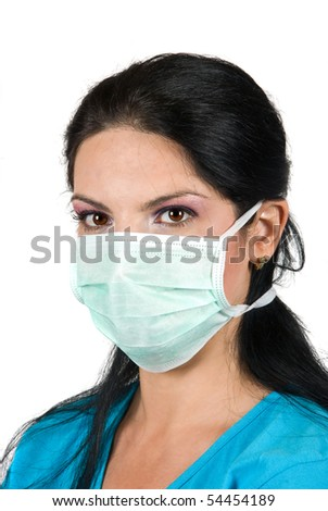 Portrait of young woman with protective mask looking at you isolated on white background