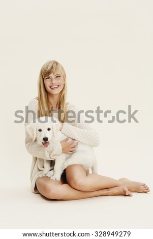Portrait of young woman with puppy - stock photo