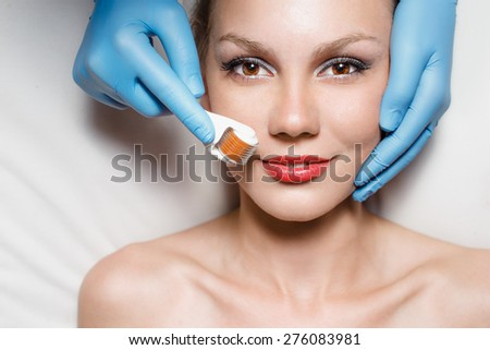 Portrait of young woman with roll-on - stock photo