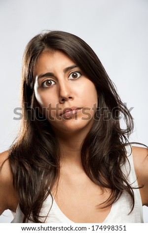 portrait of young woman with sad expression - stock photo
