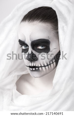 Portrait of young woman with skull make-up.  - stock photo