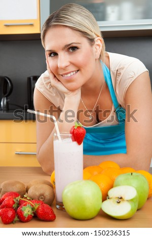 Portrait Of Young Woman With Strawberry Milkshake - stock photo