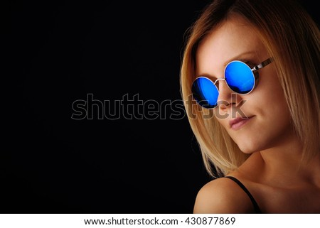 Portrait of young woman with sunglasses - stock photo