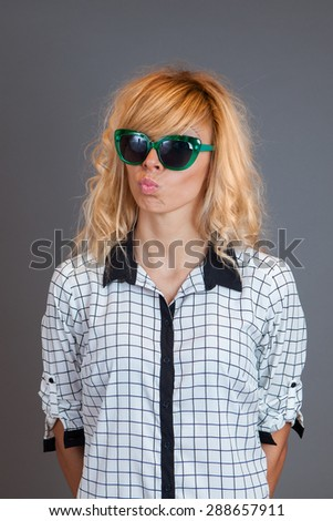 Portrait of young woman with sunglasses making a face
