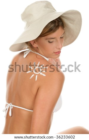 Portrait of young woman with suntan lotion isolated on white background - stock photo