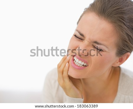 Portrait of young woman with toothache - stock photo