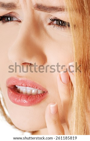 Portrait of young woman with toothache. - stock photo