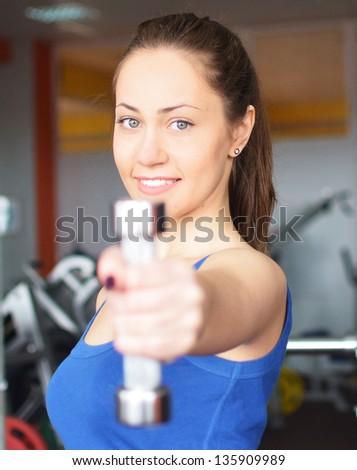 portrait of young woman working out in the gym centre - stock photo