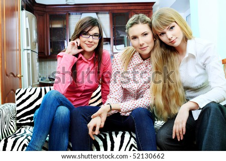 Portrait of young women having a rest together indoors. - stock photo
