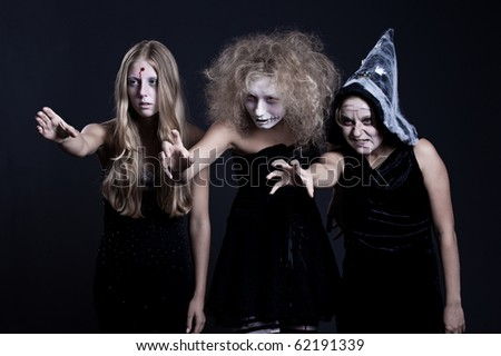 portrait of zombie, ghost and witch over black background. halloween theme - stock photo