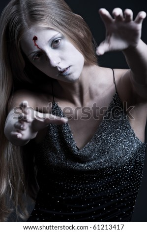 portrait of zombie with wound on forehead. halloween theme - stock photo