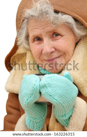 portrait old woman with mug of hot tea on white background - stock photo