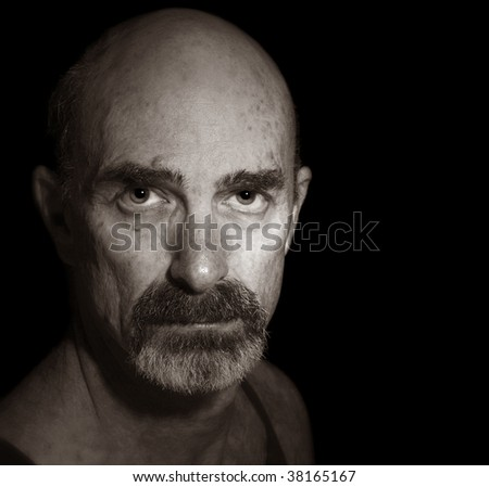 Portrait On Black of an Older Balding Man - stock photo