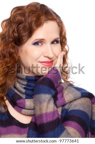 Portrait on isolated background of a young woman in winter clothes - stock photo
