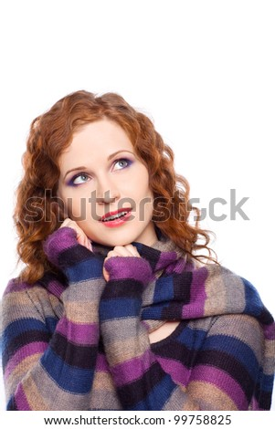 Portrait on isolated background of a young woman in winter clothes