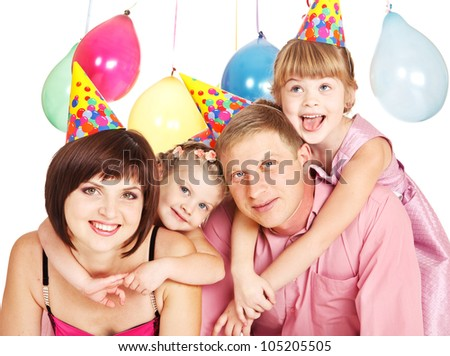 Portrait pf a family in party hats - stock photo