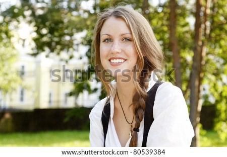 Portrait pf young beautiful girl with freckles - stock photo