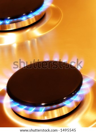 Portrait photo of two oven hob gas burners at a dynamic angle. - stock photo