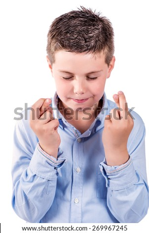 portrait photograph of a child fingers crossed on a white background - stock photo