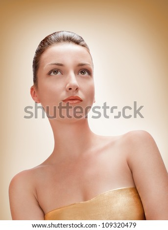 portrait picture of beautiful woman on yellow background - stock photo