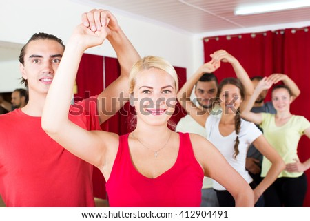 portrait positive couple dancing Latino dance in class