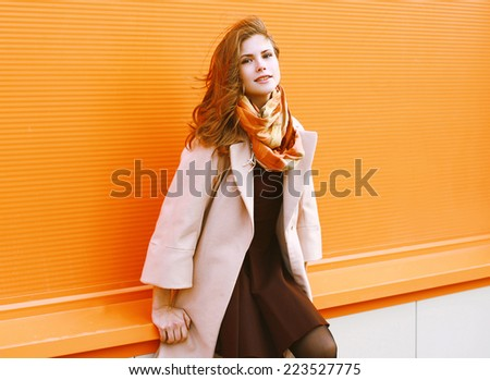 Portrait pretty sensual woman in coat posing in the city, street fashion - stock photo